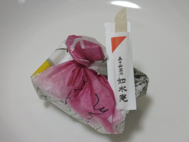 Traditional style packing, Tsukushi mochi, a kind of Japanese sweet from Fukuoka in its packaging.