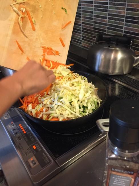pan frying carrots and lettuce, to accompany Kumamoto style ramen