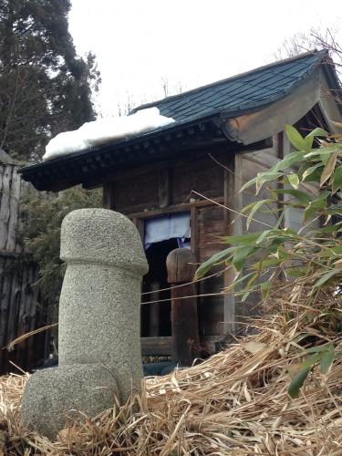 phallic statue next to hot springs (onsen)
