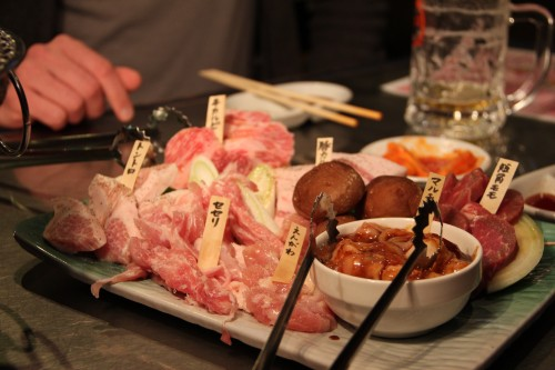 assorted meats to be grilled in a yakiniku restaurant