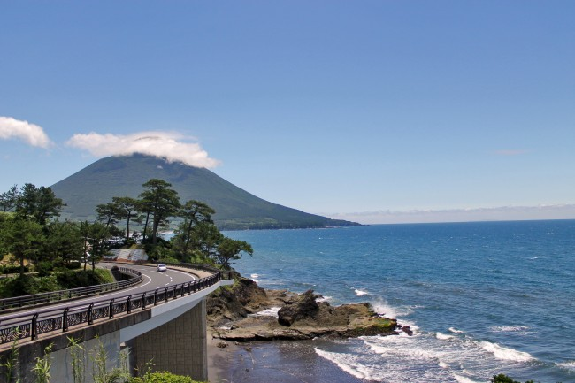 Beautiful scenery of the nature of Kagoshima at the beach with the mountain in the background.