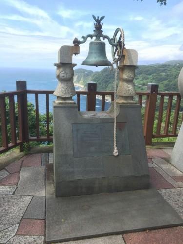 couples bell in Koibito Misaki overlooking the ocean