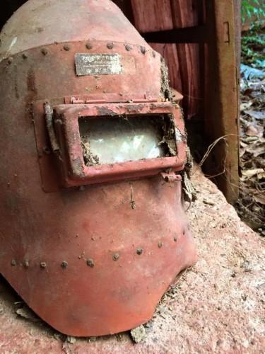 welder's helmet in an abandoned ocher factory in Okayama.