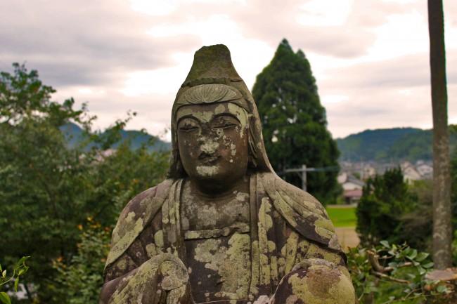Spiritual statue of Ryumondaki waterfall.