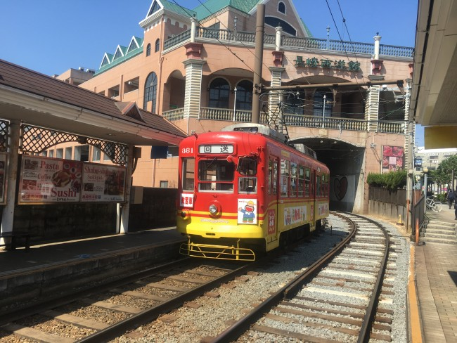 City tram as it pulls up to the platfrom in Nagasaki