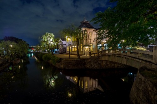 Kurashiki canal flowing through the city in Okayama, Japan also including Achi Shrine