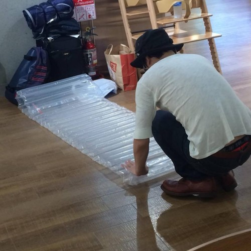 a man sets up an airbed in Narita airport Japan