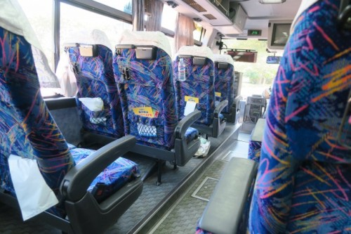 You can seat on spacious and comfortable, reclinable bus seat while taking part in a bus tour