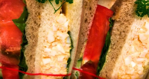 Egg salad and tomato sandwiches make an easy lunch on the go