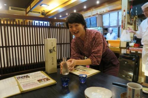 Izakaya staff will serve you tasty Sake made in Niigata!