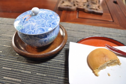 Enjoying Kyushu's famous dessert sweet and tea out of a teacup