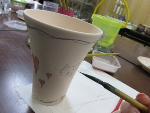 After drawing out your design on paper you can then draw directly on to the ceramic with pencil.