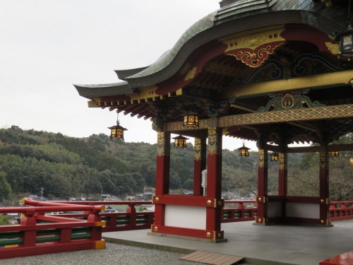 The wooden structure of Yutoku Inari Shrine is a deep red colour