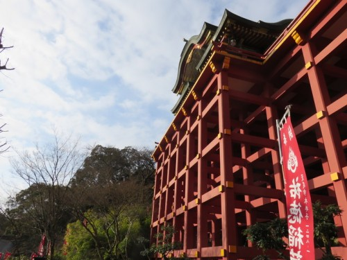 Stairs and an elevator lead up to this impressive wooden structure, Yutoku Inari Shrine