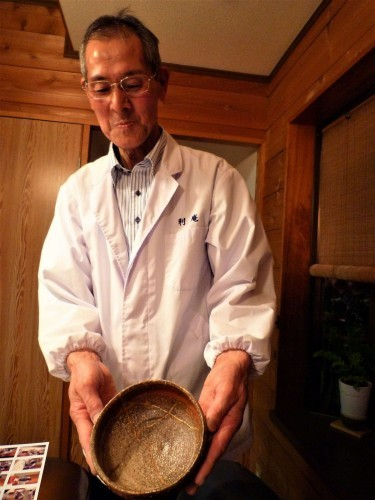 Mr. Saito, showing us one of his precious gold-injected ceramic utensils.