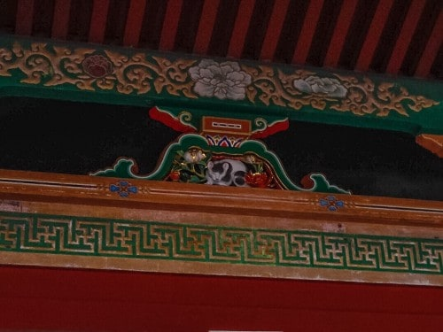 The very decadent and grand sleeping cat in Nikko Toshogu.