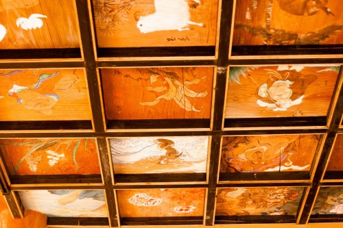 he ceiling blocks are painted with murals of folklore and symbolic images