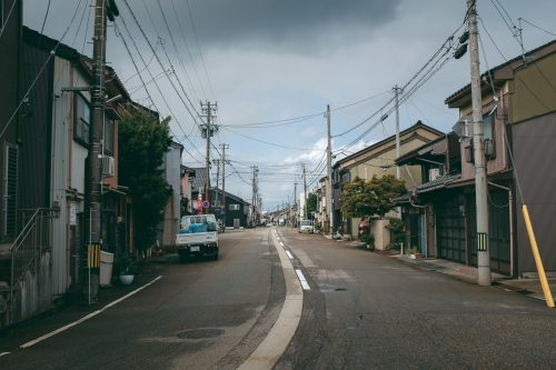 Narrow quiet streets of Takaoka city on Toyama Bay.
