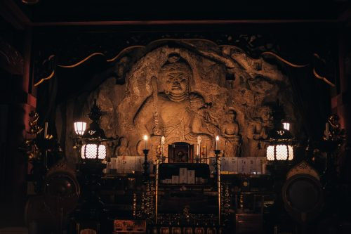 Buddhist image carved into rock, Nisseki Temple, Toyama.