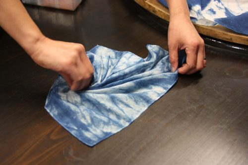 Preparing a cloth for indigo dyeing in Mima town, Tokushima.