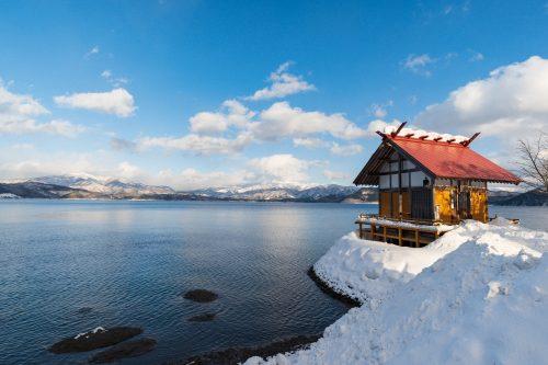 Kanagu Shrine on the shore of Lake Tazawa, Akita, Tohoku region, Japan.