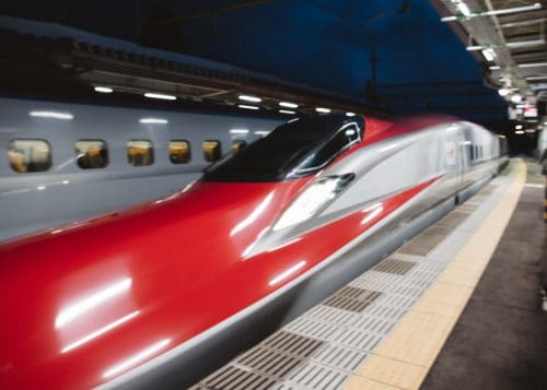 Bright red Komachi Shinkansen servicing Akita Prefecture.