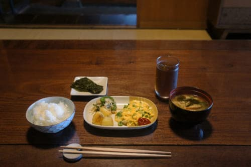 Japanese breakfast in Tomaryanse: rice, miso soup, scrambled eggs and vegetables