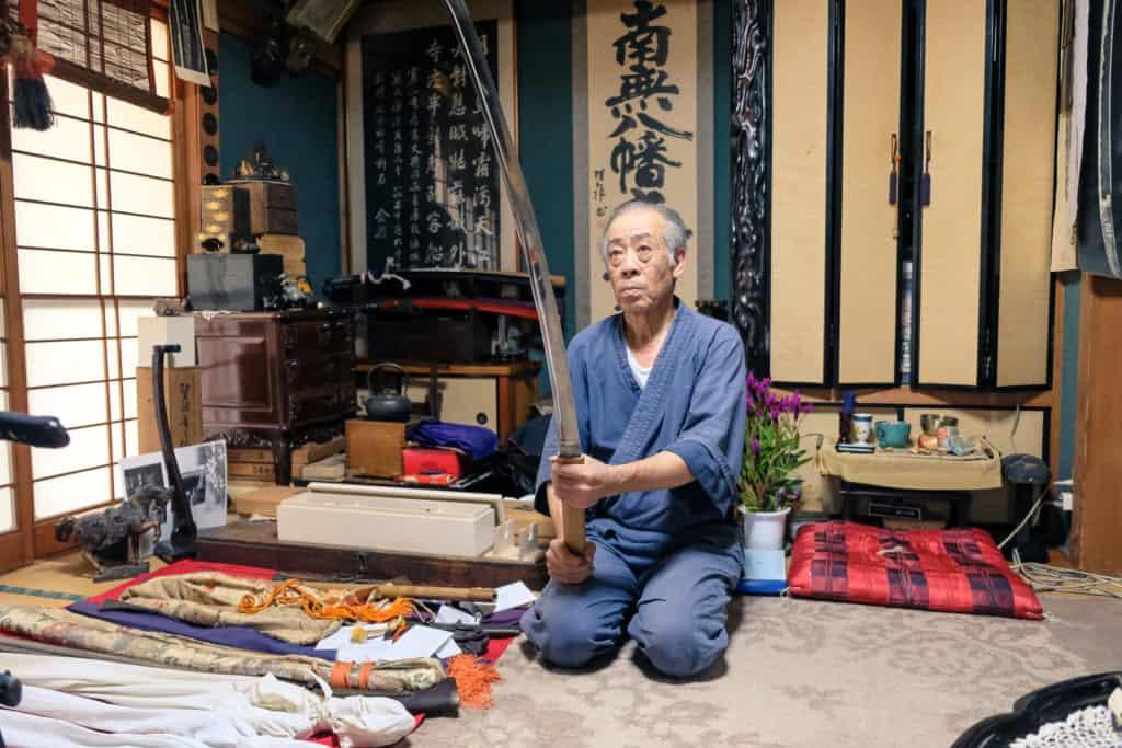 Mr. Matsunaga, holding a commissioned sword