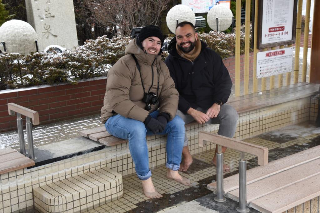 Jonathan and Mark in foot bath at Yunokawa Onsen
