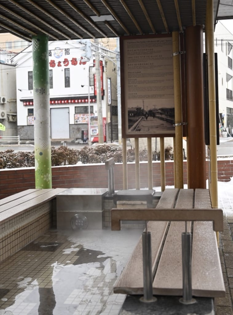 Steam rising from the foot bath at Yunokawa onsen